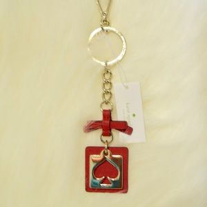 Kate spade cut out spade key fobb. Hot chili color